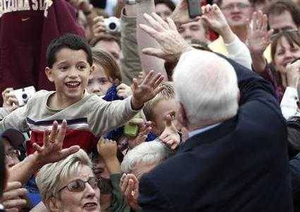 Republican presidential nominee Sen. John McCain greets supporters during a rally in Belton, Missouri October 20, 2008. REUTERS/Carlos Barria