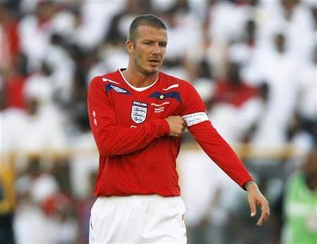 David Beckham adjusts his captain's armband during their match against Trinidad and Tobago at the Haseley Crawford stadium in Port of Spain,Trinidad, June 1, 2008. REUTERS/David Moir