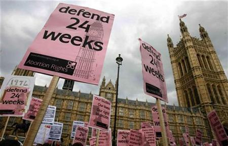 Pro-choice campaigners wave banners outside the Houses of Parliament, May 20, 2008. REUTERS/Luke MacGregor