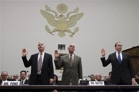 (L-R) Jerome Fons, former executive at Moody's Corporation, Frank Raiter, former executive at Standard & Poor's and Sean Egan, managing director at Egan-Jones Ratings are sworn in before testifying before the House Oversight and Government Reform Committee hearing on Credit Rating Agencies and the Financial Crisis, on Capitol Hill, October 22, 2008. REUTERS/Molly Riley
