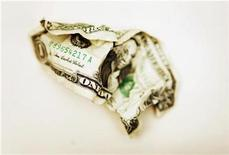 <p>A crumpled U.S. one dollar bill is displayed in Toronto October 22, 2008. REUTERS/Mark Blinch</p>