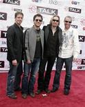 <p>Members of the band Nickleback pose for photographers on the Red Carpet at the 2007 Juno Awards in Saskatoon, Saskatchewan, April 1, 2007. REUTERS/David Stobbe</p>