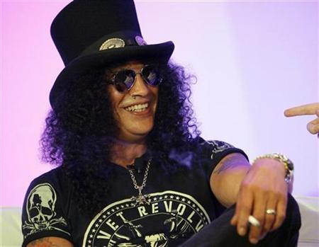 Guitarist Slash smiles at the presentation of the new Activision game Guitar Hero III during the E3 Media and Business Summit in Santa Monica, California July 11, 2007. REUTERS/Mario Anzuon