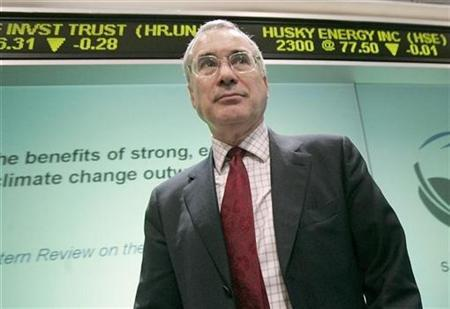 Climate change economist Nicholas Stern walks past the Toronto Stock Exchange ticker showing a quote for oil producer Husky Energy after a news conference at the Toronto Stock Exchange in Toronto, February 19, 2007. REUTERS/J.P. Moczulski