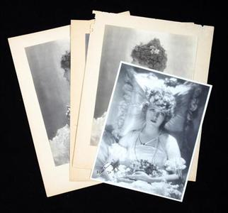 Photographs of silent film star Mary Pickford that will be auctioned are shown in this publicity photo released to Reuters October 27, 2008. More than 120 famous names from 1926 to 1981 signed the silent screen star's personal autograph book, which is among more than 750 lots from the Pickford estate going up for auction for the first time in November. REUTER/Julien's Auctions/Handout