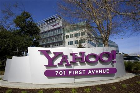 A Yahoo! signs sits out front of their headquarters in Sunnyvale, California in this February 1, 2008 file photo. Yahoo and Time Warner Inc's AOL unit are engaged in ''meaningful'' due diligence about a possible combination, but a deal is not imminent, a person familiar with the talks said on Wednesday. REUTERS/Kimberly White