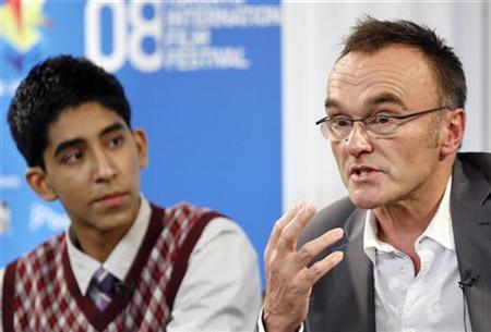 Director Danny Boyle (R) speaks beside actor Dev Patel during the '' Slumdog Millionaire'' news conference at the 33rd Toronto International Film Festival September 8, 2008. REUTERS/Mike Cassese