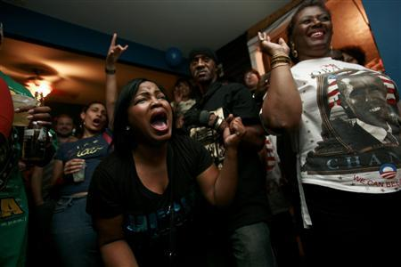 Tammy Montana (C) cheers with other bar patrons as U.S. President-elect Senator Barack Obama gives his victory speech, in New Orleans, Louisiana November 4, 2008. REUTERS/Lee Celano