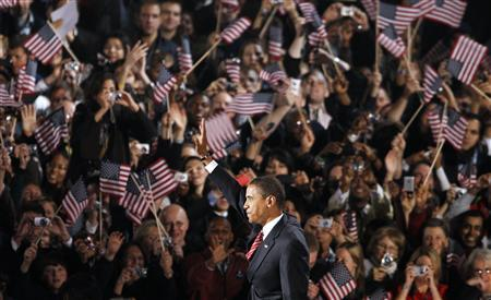 President-elect Senator Barack Obama waves to the crowd as he arrives on stage during his election night rally in Chicago, November 4, 2008. REUTERS/John Gress