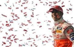 <p>Piloto de Fórmula 1 da McLaren e campeão mundial Lewis Hamilton. Hamilton é aclamado em sede da McLaren na Inglaterra.REUTERS/Toby Melville</p>