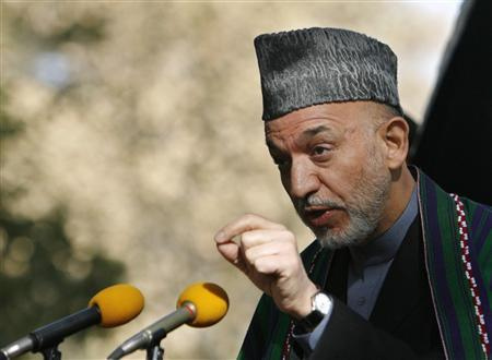 Afghan President Hamid Karzai gestures as he congratulates U.S. President-elect Barack Obama during a news conference in Kabul November 5, 2008. REUTERS/Omar Sobhani