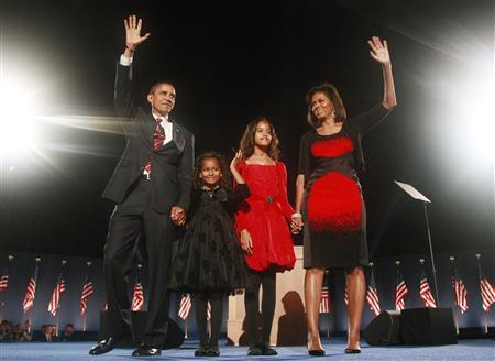 President-elect Senator Barack Obama (D-IL) along with wife Michelle (R) and daughters Sasha and Malia (2nd R) wave during his election night victory rally in Chicago November 4, 2008. REUTERS/Jason Reed