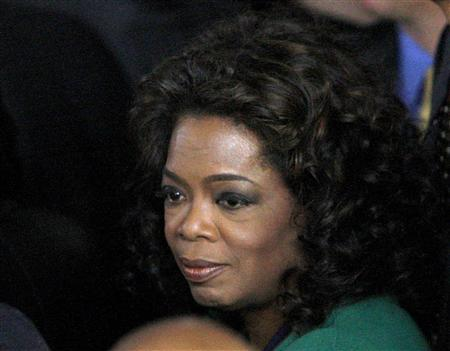 Oprah Winfrey awaits the arrival of Barack Obama at his election night rally in Chicago November 4, 2008. REUTERS/Jim Young