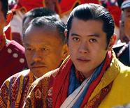 <p>Bhutan's King Jigme Khesar Namgyel Wangchuck walks with Prime Minister Jigmi Thinley (L) during his coronation ceremony in Thimpu November 6, 2008. REUTERS/Desmond Boylan</p>