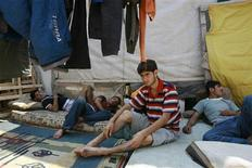 <p>Immigrants rest inside a camp at southwestern town of Patras September 1, 2008. REUTERS/John Kolesidis</p>