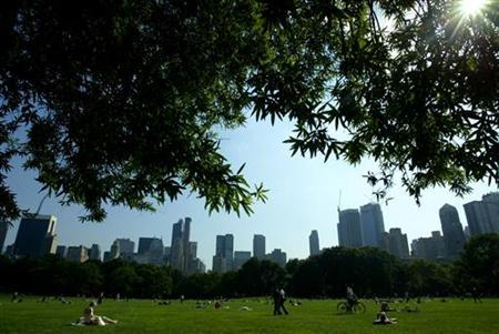 Park goers relax on the Sheep's Meadow in New York's famed Central Park in this July 15, 2003 file photo. REUTERS/Mike Segar