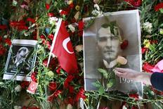 <p>A woman leaves a flower at the mausoleum of Mustafa Kemal Ataturk which is covered by his portraits, flowers and a Turkish national flag at the 70th anniversary of his death in Ankara November 10, 2008. A new film that portrays Turkey's revered founder Mustafa Kemal Ataturk as a lonely, hard-drinking man beset by doubts has whipped up emotions in a country still grappling with his legacy 70 years after his death. Ataturk, a former soldier, founded modern Turkey as a secularist republic from the ashes of the Ottoman Empire. REUTERS/Umit Bektas</p>