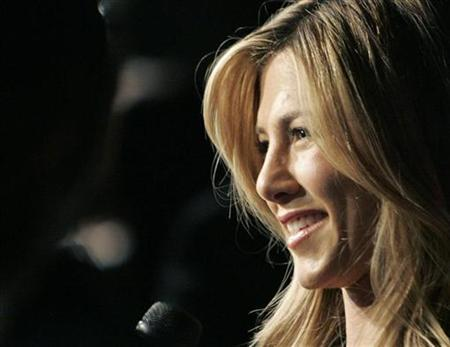 Actor Jennifer Aniston smiles during an interview at the screening of 'Management' at the 33rd Toronto International Film Festival, September 7, 2008. REUTERS/ Mike Cassese