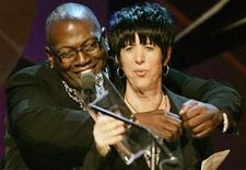<p>Music producer and judge on 'American Idol' Randy Jackson (L) presents Academy Award winning songwriter Diane Warren with the Crystal award at the Women in Film 2006 Crystal and Lucy Awards in Los Angeles June 6, 2006. Warren was honored for devoting her talents in the entertainment industry. REUTERS/Fred Prouser</p>