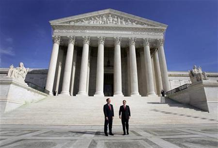 Two men stand on the front steps of the Supreme Court in Washington February 16, 2006. REUTERS/Jason Reed