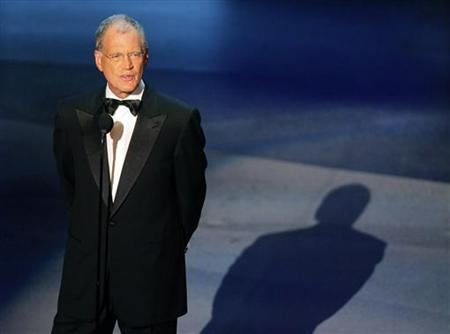 Talk show host David Letterman reads a tribute to Johnny Carson at the 57th annual Primetime Emmy Awards at the Shrine Auditorium in Los Angeles in this file photo from September 18, 2005. REUTERS/Robert Galbraith GMH/DH