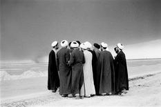 <p>A group of mullahs are seen congregating near the front-line of the Iran-Iraq war, near the southern Iranian city of Abadan. The picture, shot in 1983, is part of a London exhibition of photographs by Iranian photographer Kaveh Golestan, who died stepping on a landmine while covering the U.S. invasion of Iraq in 2003. REUTERS/Kaveh Golestan/Handout</p>