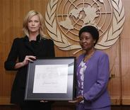 <p>Actress Charlize Theron (L) is named as a U.N. Messenger of Peace, by Deputy Secretary General Asha Rose Migiro (R), at United Nations Headquarters, in New York, November 17, 2008. REUTERS/Chip East</p>