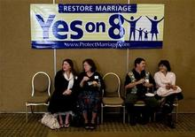 "<p>(L-R) Vivi Morris, Mary Morris, Alex Case and Ninie Case talk under a ""Yes on 8'' sign at a pro Proposition 8 election party in Irvine, California November 4, 2008. REUTERS/Fred Greaves</p>"