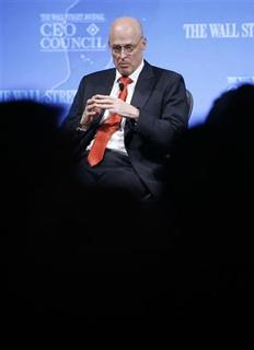 Treasury Secretary Henry Paulson listens during a forum about the global economy at the Wall St. Journal's CEO Council in Washington November 17, 2008. REUTERS/Kevin Lamarque
