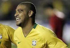 <p>Atacante Adriano comemora gol marcado no amistoso Brasil x Portugal, em Brasília. REUTERS/Bruno Domingos</p>