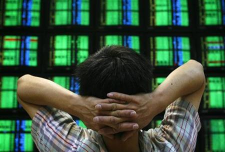 A man looks at monitors displaying stock prices inside a securities company in Taipei in this October 24, 2008 file photo. REUTERS/Nicky Loh
