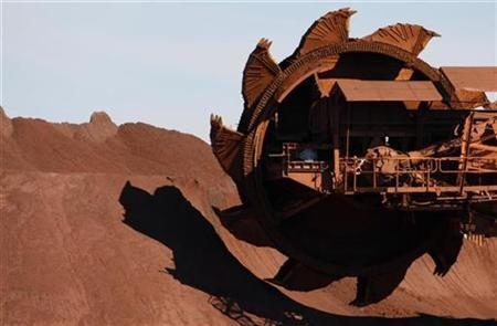 A bucket wheel reclaimer is moved into position at BHP Billiton's iron ore loading facility in Port Hedland, about 1,600 km (960 miles) north of Perth May 31, 2008. Picture taken May 31, 2008. REUTERS/Tim Wimborne