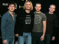 <p>Canadian rock group Nickelback (L-R), Ryan Peake, Chad Kroeger, Mike Kroeger and Ryan Vikedal, arrives at the Radio Music Awards at the Aladdin Theatre for the Performing Arts in Las Vegas, Nevada October 25, 2004. REUTERS/Steve Marcus JSH</p>
