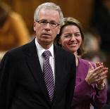 <p>Liberal leader Stephane Dion (L) receives a standing ovation from his caucus during Question Period in the House of Commons on Parliament Hill in Ottawa November 27, 2008. REUTERS/Chris Wattie</p>