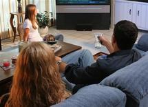 <p>A family watches television in an undated photo. Spending a lot of time watching TV, playing video games and surfing the Web makes children more prone to a range of health problems including obesity and smoking, U.S. researchers said on Tuesday. REUTERS/Handout</p>