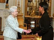 <p>Britian's Queen Elizabeth speaks with Secretary of State Condoleezza Rice before a private musical concert with members of the London Symphony Orchestra at Buckingham Palace in London, December 1, 2008. REUTERS/John Stillwell/Pool</p>