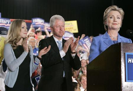 Senator Hillary Clinton along with daughter Chelsea (L) and husband former President Bill Clinton (C) speaks to supporters at her North Carolina and Indiana primary election night rally in Indianapolis, Indiana, May 6, 2008. REUTERS/John Gress