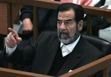 <p>Saddam Hussein reacts in court during the Anfal genocide trial in Baghdad December 21, 2006. REUTERS/Nikola Solic</p>