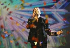 <p>Il leader dei Coldplay Chris Martin agli American Music Awards a Los Angeles. REUTERS/Mario Anzuoni</p>