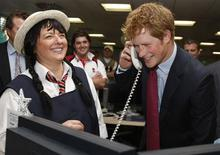 <p>Britain's Prince Harry (R) closes a 250 million euro deal with broker Amanda Hartnell (L) at the offices of city traders ICAP in London, December 10, 2008. REUTERS/ Kirsty Wigglesworth/Pool</p>