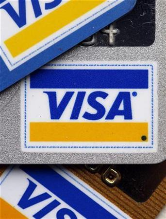 Regular, platinum and gold Visa cards are displayed in New York March 18, 2008. REUTERS/Chip East