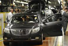 "<p>Employees of German car manufacturer Opel work on their company's latest model ""Insignia"" inside the assembly hangar of General Motors German unit Opel's headquarters in Ruesselsheim, in this December 3, 2008 file photo. REUTERS/Kai Pfaffenbach</p>"