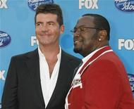 <p>Simon Cowell (L) and Randy Jackson, two of the judges on the American Idol television show, arrive for the show's season finale in Los Angeles, California May 21, 2008. REUTERS/Fred Prouser</p>