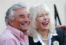 <p>Actor Peter Falk (L) and actress Loretta Swit attend the unveiling of actor Wayne Rogers' star on the Hollywood Walk of Fame in Hollywood December 13, 2005. . REUTERS/Phil McCarten</p>
