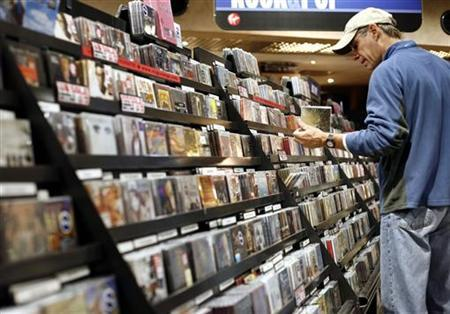 A man looks at music CD's inside the Virgin Megastore in New York in this file photo from November 26, 2007. REUTERS/Shannon Stapleton
