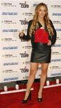 """<p>Foto de archivo de la actriz Lindsay Lohan en el concierto """"Stand Up For A Cure"""" en Nueva York, 10 sep 2008. Un admirador de la actriz Lindsay Lohan fue arrestado en la mañana del miércoles tras empujar a un guardia de seguridad de un club nocturno y tratar de agarrar a la artista, informó la policía. REUTERS/Lucas Jackson</p>"""