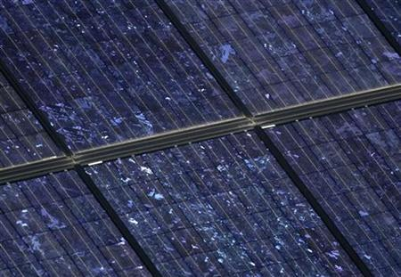 A solar panel glistens under the sun in Ota, northwest of Tokyo in this October 28, 2008 file photo. REUTERS/Yuriko Nakao