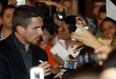 <p>British actor Christian Bale signs autographs before a photocall for 'The Dark Knight' film in Barcelona, in this file photo from July 23, 2008. REUTERS/Albert Gea</p>