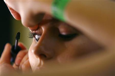 A model has her make-up applied backstage before the Kisa Spring/Summer 2008 collection show during London Fashion Week September 19, 2007. REUTERS/Luke MacGregor