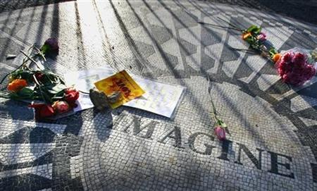 Flowers and messages lie on a tile mosaic memorializing John Lennon in the Strawberry Fields section of Central Park on the 26th anniversary of the death of the singer, in New York December 8, 2006. REUTERS/Mike Segar